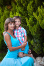 Mother and son in garden green Royalty Free Stock Image