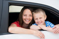 Mother and son happy looking out the car window Royalty Free Stock Image