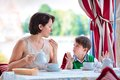 Mother and son having breakfast together at cafe Royalty Free Stock Photo