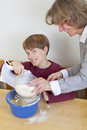 Mother and son having fun in kitchen Royalty Free Stock Images