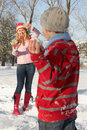 Mother And Son Having Snowball Fight Stock Photos