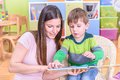 Mother and son in kindergarten adaptation to Royalty Free Stock Photos