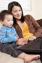 Mother and son with laptop Royalty Free Stock Photo