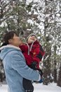 Mother and son look at snow. Stock Photos