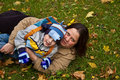 Mother and son lying on grass Royalty Free Stock Photo