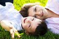 Mother and son lying on grass Stock Photo