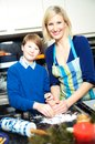 Mother and son making cookies in a kitchen Stock Photo