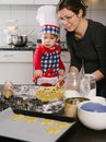 Mother and son making cookies photo of an adorable boy in a chef hat apron his in the kitchen Stock Images