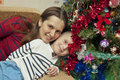 Mother and son near Christmas tree Royalty Free Stock Photo