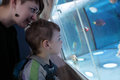 Mother with son at oceanarium her looking fishes Royalty Free Stock Photography