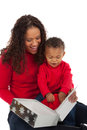 Mother and son open christmas gift box african american boy with mom Stock Photo