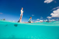 Mother and son paddling on stand up paddle board Royalty Free Stock Photo