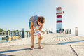 Mother with son on pier at the lighthouse, sunny summer Royalty Free Stock Photo