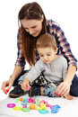 Mother and son playing with clay dough young women her boy plasticine on white background Royalty Free Stock Photo
