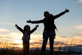 Mother and son playing on the coast of lake  of at the sunset ti Royalty Free Stock Photo