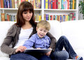Mother and son playing with digital touchpad Royalty Free Stock Photo