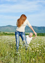 Mother and son playing in field baby are Royalty Free Stock Image