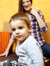Mother and son playing her little boy having fun indoors Stock Photo
