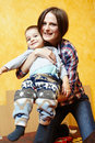 Mother and son playing her little boy having fun indoors Royalty Free Stock Photo