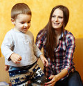 Mother and son playing her little boy having fun indoors Royalty Free Stock Photography