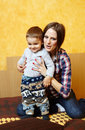 Mother and son playing her little boy having fun indoors Stock Images