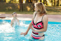 Mother with son in pool young splashing Royalty Free Stock Photos