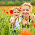 Mother and son in poppy field Royalty Free Stock Images