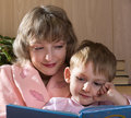Mother and son read book Stock Photo