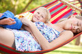 Mother And Son Relaxing In Hammock Royalty Free Stock Photo