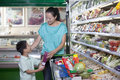 Mother and son shopping for groceries in supermarket beijing Royalty Free Stock Photo