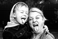 Mother and the son show tongue Royalty Free Stock Photography