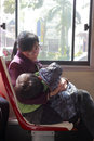 Mother and son sleep on the bus in amoy city china Royalty Free Stock Images