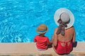 Mother and son at the swimming pool on vacation Royalty Free Stock Image