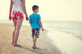 Mother with son waling on sea coast Royalty Free Stock Photo