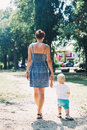 Mother and son walking outdoors Royalty Free Stock Photo