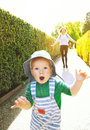 Mother and son walking outdoors on the nature background with co Royalty Free Stock Photo