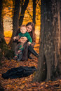 Mother and son young with her baby boy at fall forest sunset Stock Images