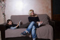 Mother and sons her in a relax moment of the day Stock Image