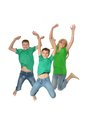 Mother and sons jumping in studio on a white background Royalty Free Stock Images
