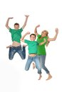 Mother and sons jumping in studio on a white background Stock Photos