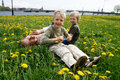 Mother with sons in meadow Royalty Free Stock Images