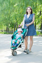 Mother with stroller Royalty Free Stock Photos