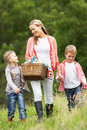 Mother taking children on picnic in countryside smiling Stock Photography