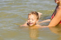 Mother teach her son to swim in lake Stock Photo