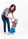 Mother teaching baby to walk Royalty Free Stock Photos