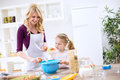 Mother teaching child how to make dough Royalty Free Stock Photo