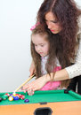 Mother teaching daughter play billiard Royalty Free Stock Photography