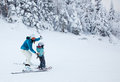 Mother teaching her child to ski at mont tremblant canada february a is down an easy slope resort it is Stock Images