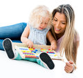 Mother teaching her daughter the abacus isolated over white background Royalty Free Stock Photos