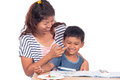 Mother tease her son while doing homework Stock Photo